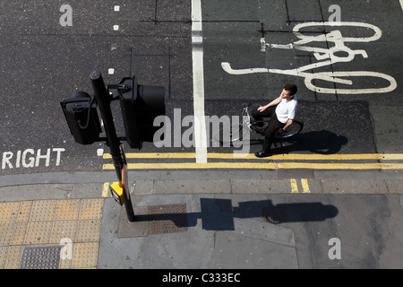 Cyclist on the road waiting for the traffic light - Stock Photo