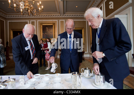 HRH Duke of Edinburgh, Prince Philip, pours tea for himself and others at the Royal Society of Edinburgh where he - Stock Photo