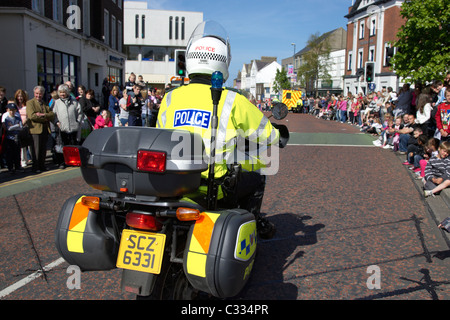 psni police motorcycle traffic control officer escort during parade in bangor county down northern ireland - Stock Photo