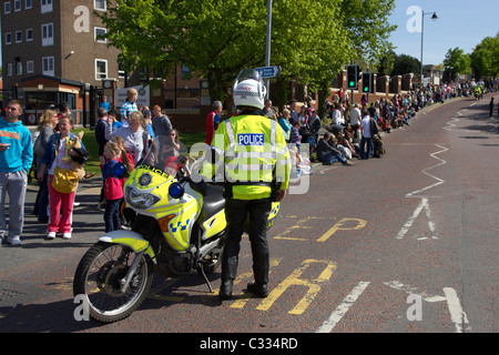 psni police motorcycle traffic control officer standing waiting on parade in bangor county down northern ireland - Stock Photo