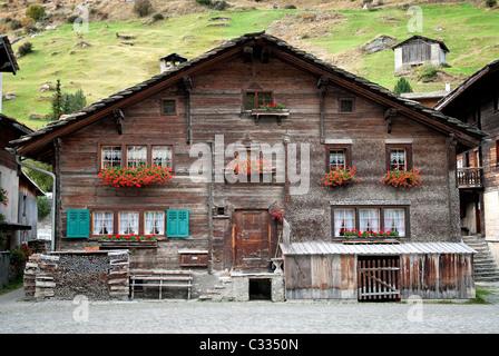 traditional alpine wooden house in vals village switzerland - Stock Photo