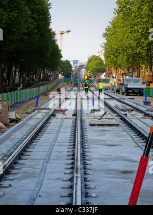 Paris, France, Tramway T3 Construction Site, Men Laying Tracks on City Street - Stock Photo
