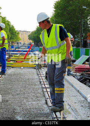 Paris, France, Tramway T3 Workers at Construction Site, Men Pouring Concrete for Tracks Support, Supervisor on Street - Stock Photo