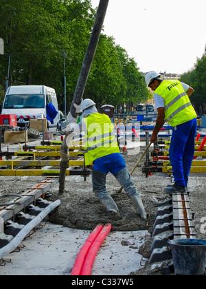 Paris, France, Tramway T3 Construction Site, Pouring Concrete, Men Laying Tracks - Stock Photo