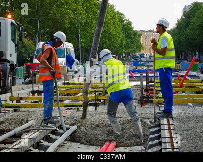 Paris, France, Tramway T3 Workers at Construction Site, Men Laying Tracks, Pouring Concrete, immigrants Europe - Stock Photo