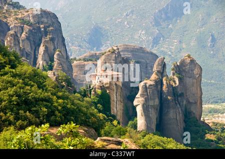 The Roussano Monastery Amongst the Spectacular Meteora Mountains, Meteora, Plain of Thessaly, Greece, Europe - Stock Photo