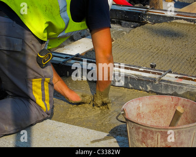 Paris, France, Tramway T3 Workers at Construction Site, Man Working in Concrete, Laying Tracks - Stock Photo