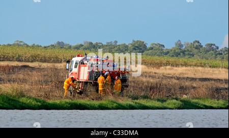 Volunteer Firefighters at their fire truck after attending a grass fire. Pokolbin, Hunter Valley, NSW, Australia. - Stock Photo