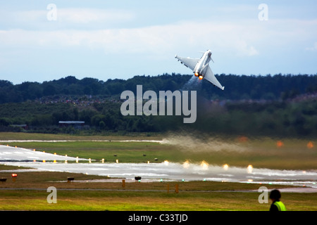 Royal Air Force Eurofighter EF-2000 Typhoon F2 powerful take off at Farnborough International Airshow 2010, UK. - Stock Photo