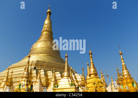 Golden Stupas, Pagodas, and Shrines at the Buddhist Temple of Shwedagon Paya in Yangon, Myanmar - Stock Photo