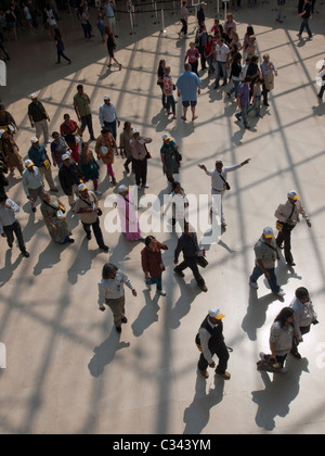 Crowds of tourists visiting The Louvre museum in Paris France - Stock Photo