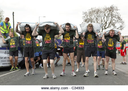 The World Coal Carrying Championships . Preparation for the Mens competitive race Gawthorpe West Yorkshire England - Stock Photo