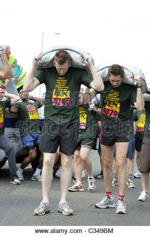 The World Coal Carrying Championships. Preparation for the Mens competitive race Gawthorpe near Wakefield West Yorkshire - Stock Photo