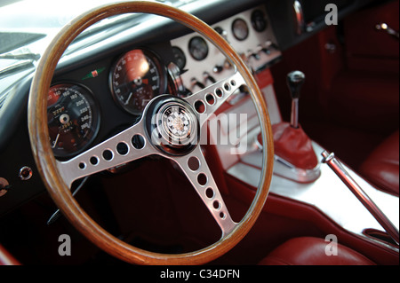 Detail shot of steering wheel and gear box of a Jaguar E Type vintage british sports car - Stock Photo