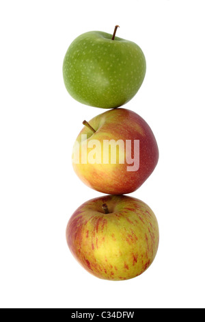 Three apples, appear as if stacked, isolated on a white background. Granny Smith, Braeburn and Cox varieties. - Stock Photo