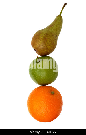 A pear, apple and an orange appear as if stacked on top of each other. Isolated on a white background. - Stock Photo