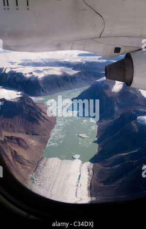 Plane flying towards Narsarsuaq airport, South Greenland - Stock Photo