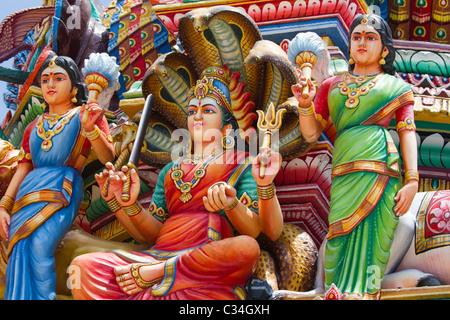Sri Mariamman Hindu Temple in Singapore - pantheon of painted deities 18 - Stock Photo