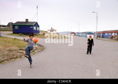 Boys playing soccer, Narsaq, South Greenland - Stock Photo