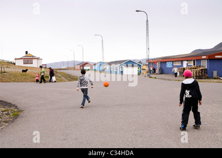 Boys playing soccer, Narsaq, South Greenland - Stock Photo