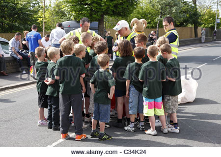 Boys receiving their instructions in preparation for the coal race . Gawthorpe World Coal Carrying Championships - Stock Photo