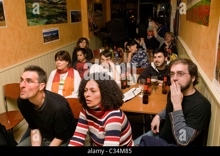 Barça fans watching F.C Barcelona losing against Real Madrid. - Stock Photo