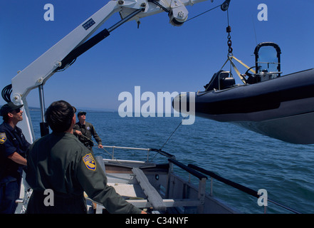 Fish and wildlife law enforcement boat moored at st for California fishing game