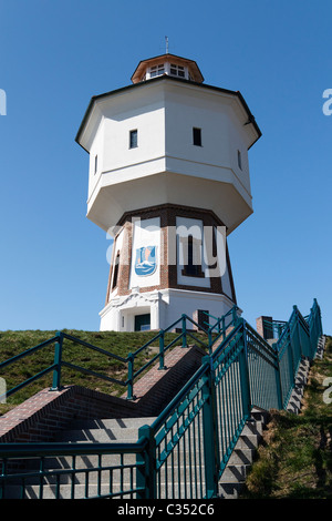 Built in 1909, is the Langeoog's water tower the landmark of the German East Frisian Island Langeoog. - Stock Photo