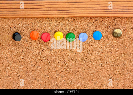 macro shot of coloured pins in anoticeboard - Stock Photo