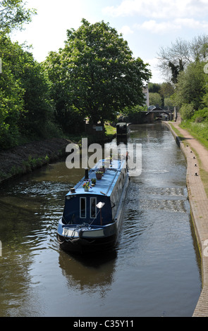 Pretty narrowboat on the Staffordshire and Worcestershire Canal at Compton locks near Wolverhampton on a sunny day - Stock Photo
