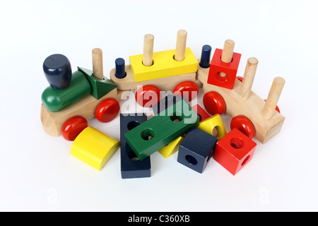 a colorful wooden train toy for children on white paper - Stock Photo