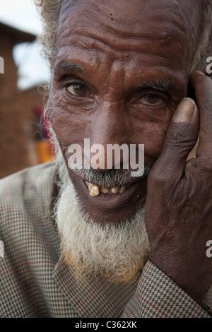 An elderly Argoba man smiles in the village of Koremi, outside Harar in eastern Ethiopia, Africa. - Stock Photo