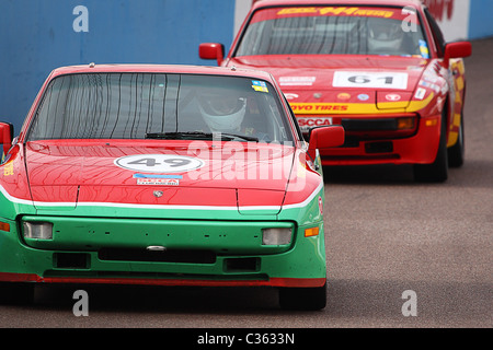 Two spec porsche 944 cars on track - Stock Photo