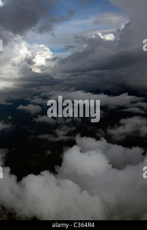 aerial photography above cumulus clouds between layers - Stock Photo