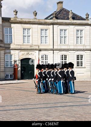Livgarden (Royal Life Guards) in front of Amalienborg palaces Copenhagen Denmark Scandinavia - Stock Photo