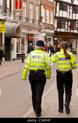 Two Police Community Support Officers on the street in Cambridge , Cambridgeshire , England , Britain , Uk