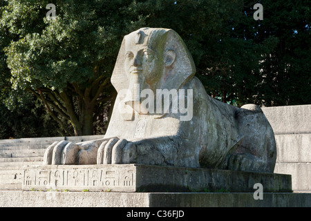 Statue of an Egyptian sphinx at the foot of the site of the Crystal Palace building that was destroyed in a fire - Stock Photo