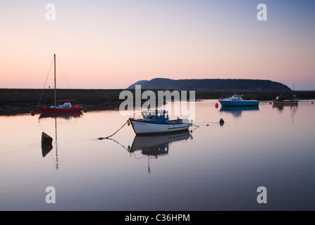 Boats moored on the River Axe with Brean Down in the distance. Somerset. England. UK. - Stock Photo