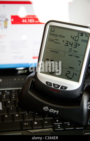 An EON electricity smart meter monitoring live consumption of electricity in a domestic property England UK - Stock Photo