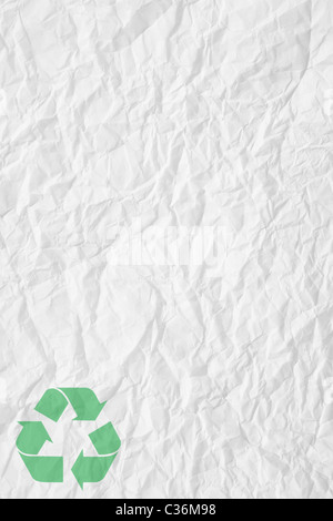texture of white crumpled paper and green recycling sign - Stock Photo
