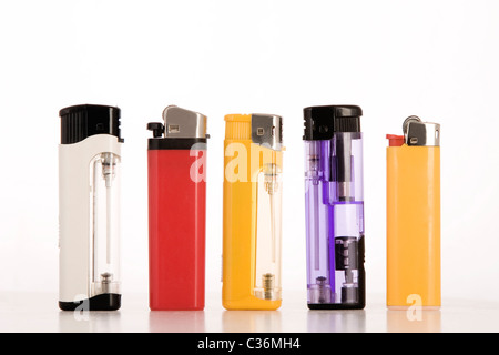 front view of colored lighters on white background - Stock Photo
