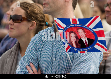 royal wedding revellers with flag with prince william and Catherine Middleton hyde park - Stock Photo
