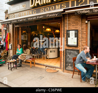 People at Street Cafe Damascus Bite in Brick Lane in the East End of London - Stock Photo