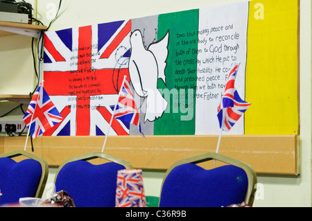 Union Jack and Irish Tricolour at a Cross Community Centre in the Shankill Road. - Stock Photo