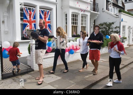 Royal Wedding Street Party food Chelsea London. Prince William and Catherine souvenir masks. April 29 2011. Bunting - Stock Photo