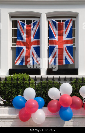 Royal Wedding Street Party. Bunting exterior Chelsea London April 29 2011 2010s UK Red white and blue balloons and - Stock Photo
