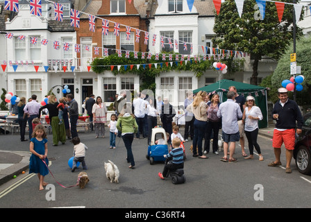 Royal Wedding Street Party food Chelsea London. Prince William and Catherine  April 29 2011. Bunting red white and - Stock Photo