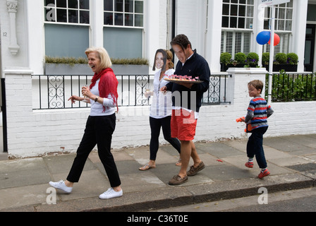 Royal Wedding Street Party. Chelsea London. Prince William and Catherine souvenir masks. April 29 2011. - Stock Photo