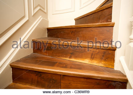 Varnished wooden floor in a central London home - stairs - Stock Photo