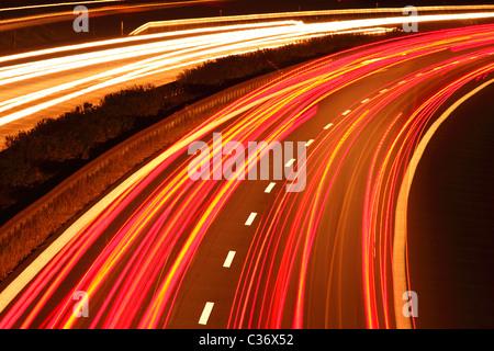 light trails on German Motorway A 14 - Stock Photo